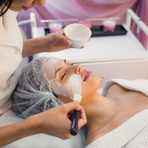 Young beautiful woman having spa procedure on her face.